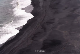 A beautiful graphic looking at the black sand beach from the Dyrhólaey Lighthouse near Vík, Iceland.