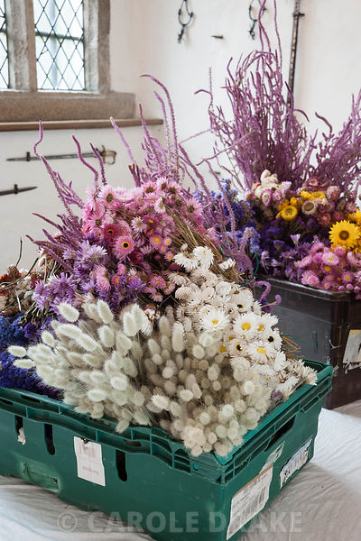 Boxes of dried flowers prepared and counted, ready to be attached to the pittosporum base of the Christmas garland in the Gre...