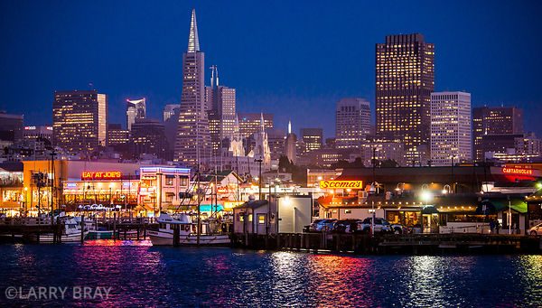 View across the  water to Fishermans Wharf at night with the city lit up in the behind  in SanFrancisco, California, USA