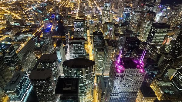 Bird's Eye: Medium Shot Above the Tallest Beacons of Chicago's Dense Skyline at Night