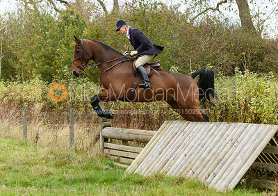 Zoe Mossman jumping a hunt jump near Peake's. The Cottesmore Hunt at Somerby