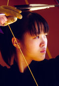Japan - Kyoto - A Kyudo student draws her bow