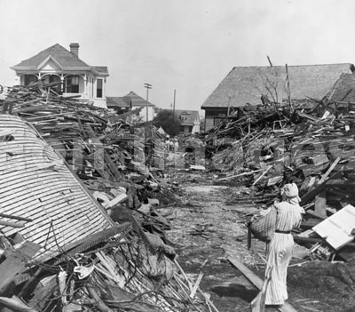 An opened passageway in the debris, North on 19th Street, Galveston, Texas