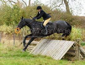 Adrienne Collie jumping a hunt jump near Peake's. The Cottesmore Hunt at Somerby
