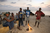 Fishermen sitting at a fire on the beach, Beira, Mozambique