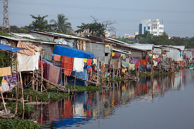 A shantytown on the banks of a small lake that is locally referred to as Kalighatpur, near Science City in Kolkata, India.