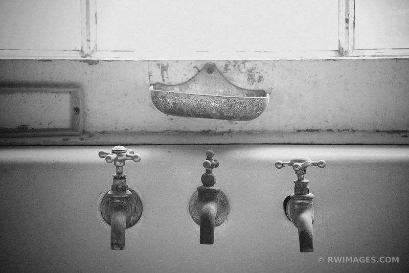 THREE FAUCETS PLUM ORCHARD MANSION INTERIOR CUMBERLAND ISLAND GEORGIA BLACK AND WHITE