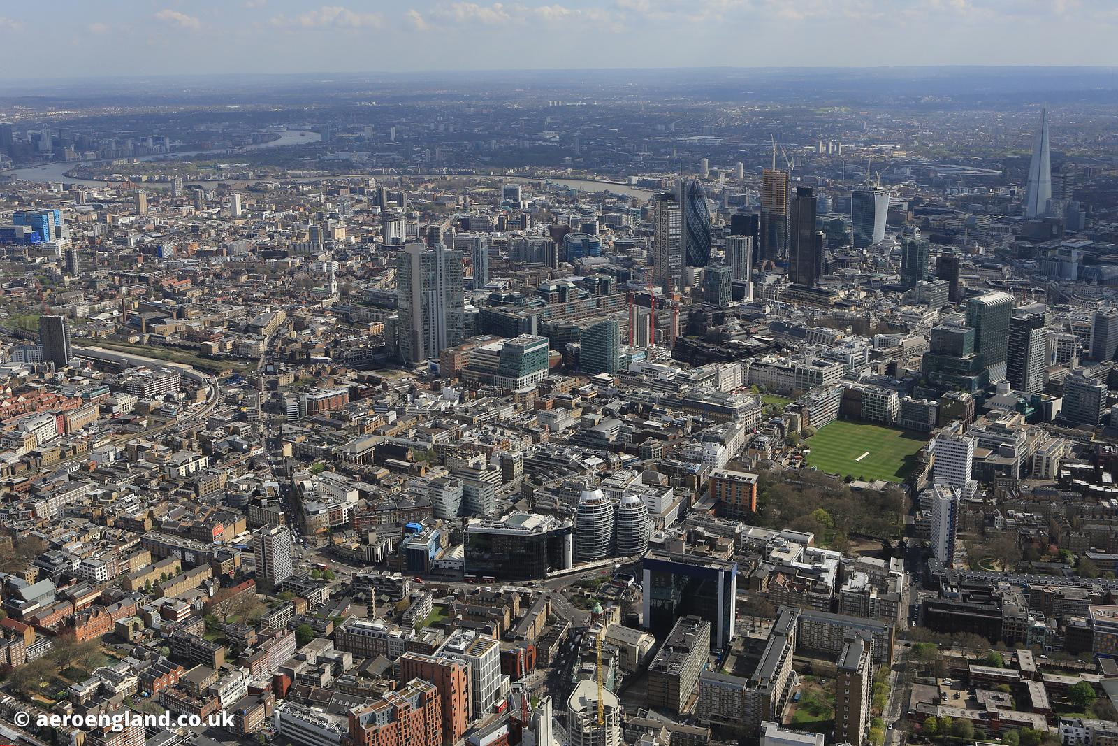 aerial photograph of the area around City Rd London EC1Y 2BP showing Old St EC1V 9DD in the foreground and the City of London financial district in the background.
