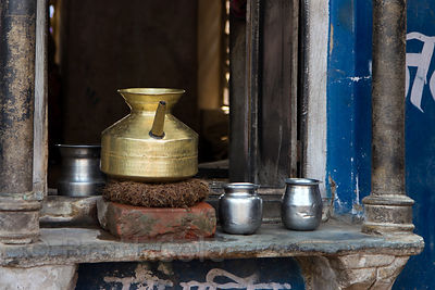 Metal drinking water cups and pot, Pushkar, Rajasthan, India