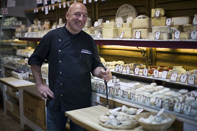France - Paris -  Patrick Soub in the Androuet cheese shop in the market  on the Rue Mouffetard.