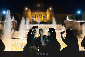 Tourists taking selfies at the light and water show at the The Magic Fountain of Montjuïc (Font màgica de Montjuïc) in Barcel...