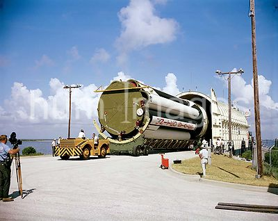 (1966) --- A stage of the uprated Saturn 1 launch vehicle unloaded from NASA barge Promise after arrival at Cape Kennedy. Lau...