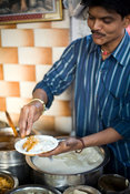 India - Delhi - A man makes different kinds of chat (street food snacks) at the Ashok Chat Corner in Chawri Bazaar