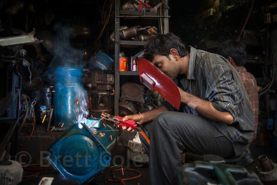 A welder works at a shop in the Dharavi slum, Mumbai, India.