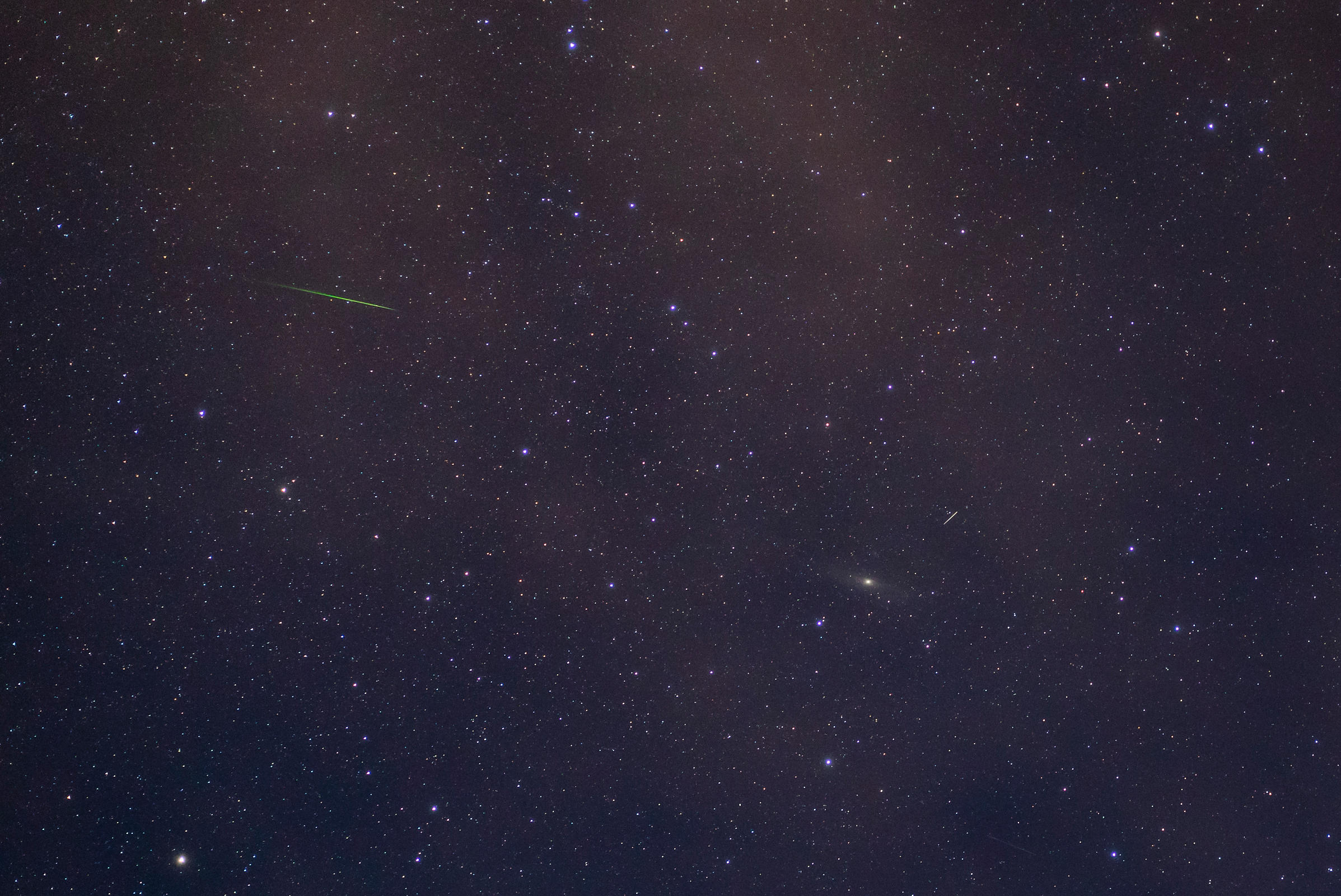 Lone Perseid meteor during the annual Perseid meteor shower, with Andromeda galaxy in the background. Photographed in Souther...