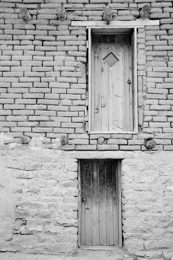 TWO DOORS ADOBE STYLE ARCHITECTURE NORTHERN NEW MEXICO BLACK AND WHITE VERTICAL