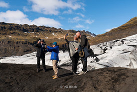 Tourists taking selfies near the Sólhelmajökull glacier in Iceland.