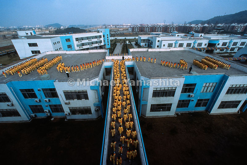With assembly-line precision, students at the exclusive Guangdong Country Garden School file back to classrooms after morning...