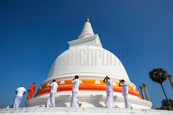 Buddhist Monks Wrapping Colured Flags around Thuparama Dagoba During Full Moon Poya Day