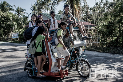 The School Run - Kids Coming Home From School By Tricycle In The Philippines