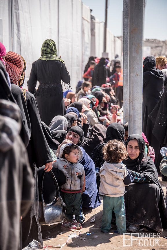The Women's Queue In The Transit Area At Hamam al Alil IDP Camp. When They Eventually Reach The Front, They Will Get A Basket...