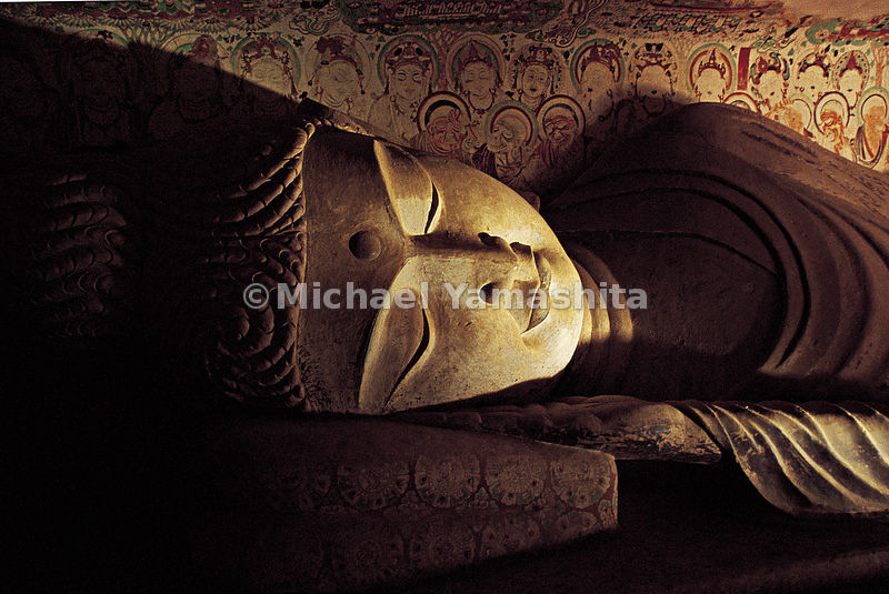 A reclining Buddha in Mogao Caves. The Buddhist art in this site was created between the fifth and eighth centuries.