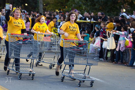 Parade participants pass by during the  University of Iowa homecoming Parade in Iowa City on Friday September 28, 2012. (Just...