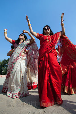 Women from a family dance at Babughat during the Durga Puja festival, Kolkata, India. They're about to immerse the family's i...