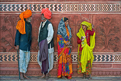 These rural Rajasthani men and women take a break from their visit to Taj Mahal and chat. This photograph was shot against a ...