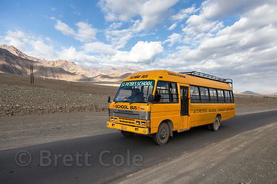 A school bus on the Himalayan desert near Stok village, Ladakh, India