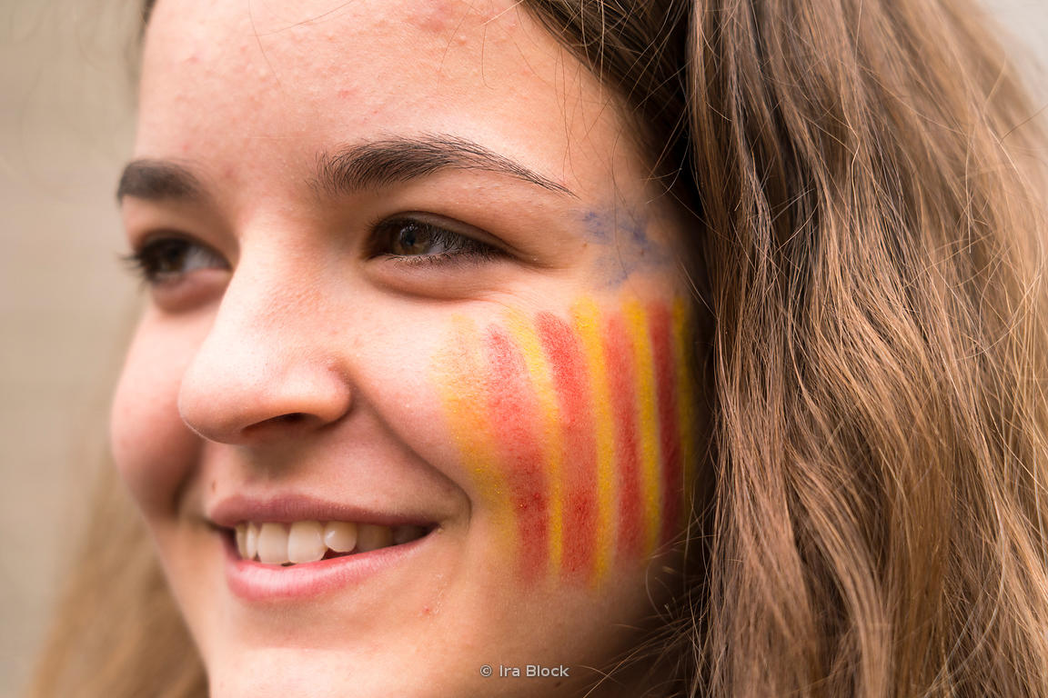 A protestor with the secession flag painted on her cheek for the protests for Catalonia independence at La Rambla in Barcelon...