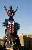 Masked dancer at the Dama festival, Ireli village below the Bandiagara escarpment, Dogon Country, Mali