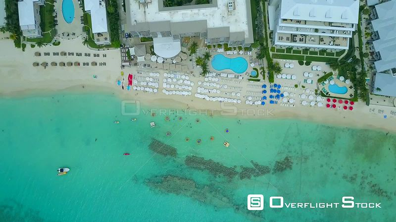 People Sunbathing and Swimming Marriott Beach Resort Cayman Islands Caribbean\