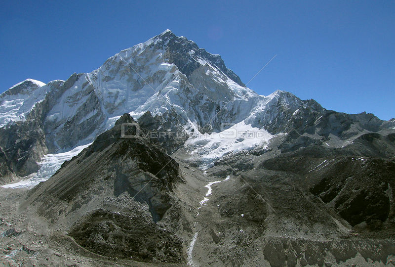NEPAL Mount Nuptse -- 16 Apr 2005 -- The glacier pictured here on the slopes of Mount Nuptse is one of several icy tributarie...