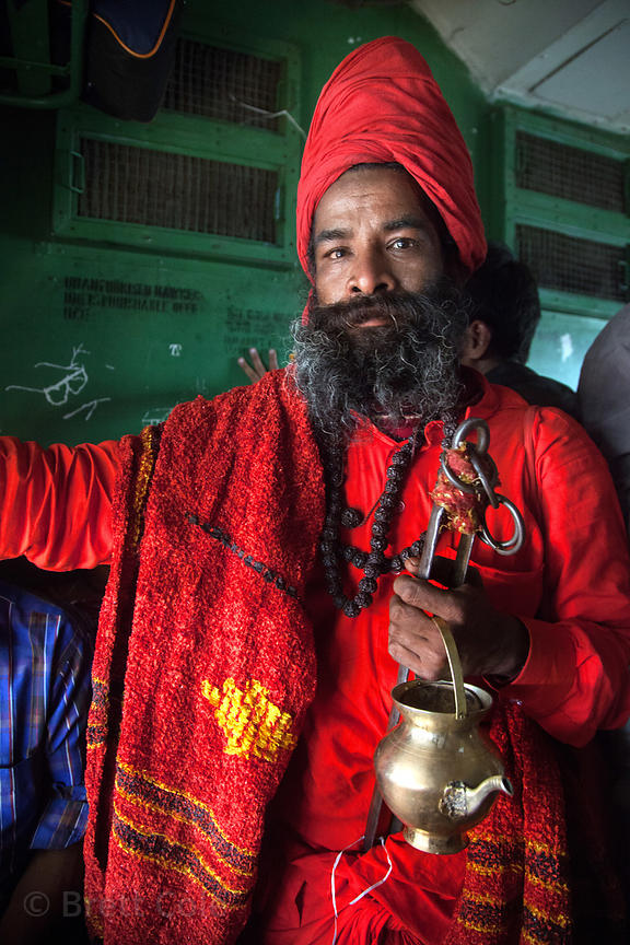 Pilgrims ride a train from Kolkata to Sagar Island, India for the Gangasagar Mela, a Hindu pilgrimage that attracts a million...