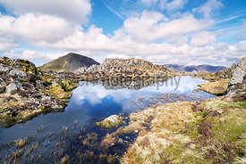 Views of the summit of High Crag and reflections of the sky in a mountain tarn from the summit of Hay Stacks in the English L...