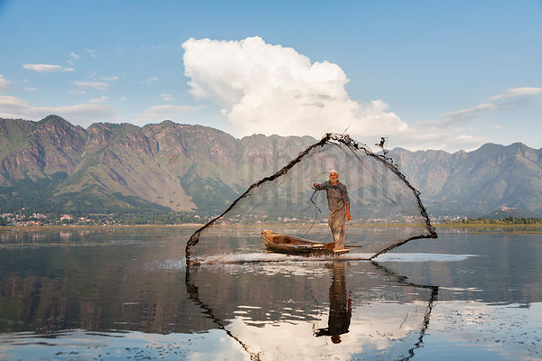 Fisherman Throwing Cast Net