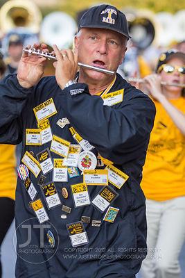 Nile Dusdieker of North Liberty marches with the Alumni Band in the 2012 University of Iowa homecoming Parade on Washington S...