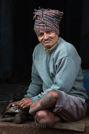 Man with no feet polishing pots in Jodhpur, Rajasthan, India