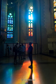 Tourists inside Sagrada Família, a church built by the renowned architect Antoni Gaudí in Barcelona, Spain.