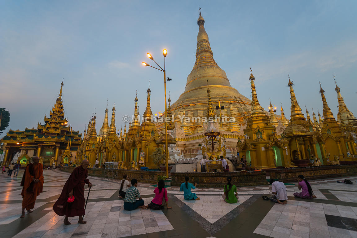 The devout kneel down before Shwedagon Pagoda, widely considered Myanmar's greatest treasure, a massive gold-plated wonder to...