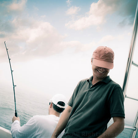 male friends deep sea fishing