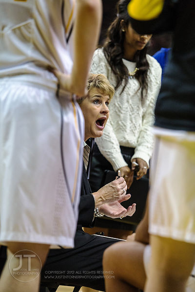 Iowa head coach Lisa Bluder addresses the team during a timeout versus Purdue during the second half of play at Carver-Hawkey...