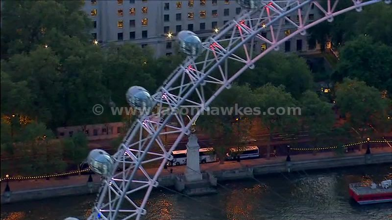 Aerial footage of the London Eye and the Royal Air Force memorial, London, England, UK