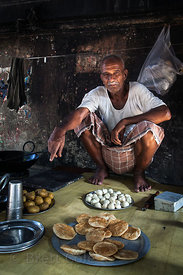 A man tends his food stall near the Howrah Flower Market, Kolkata, India.
