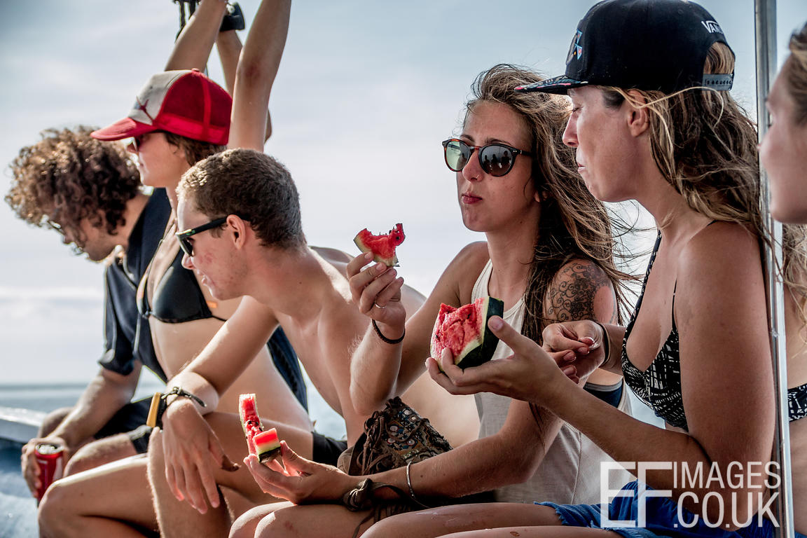 Friends On A Boat Eating Watermelon