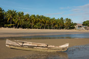 Fishing boat lying on a palm-lined beach, Nosy Be, Madagascar