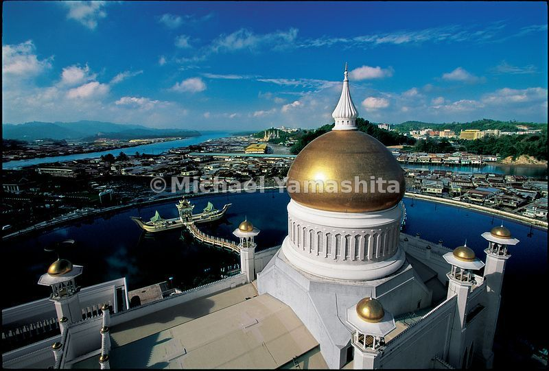 The mosque with its golden dome looms over the warren of stilt houses that line the river in Burnei's capital, Bandar Deri Be...