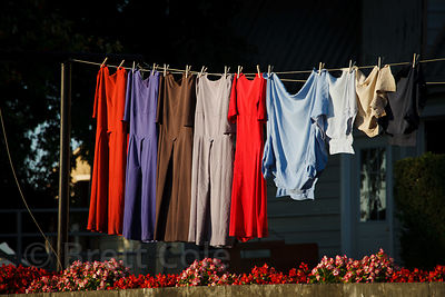 Simple, solid colored ladies dresses drying on a laundry line, Amish country, Lancaster, Pennsylvania