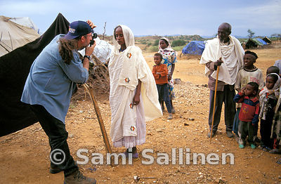 Idp woman and photographer